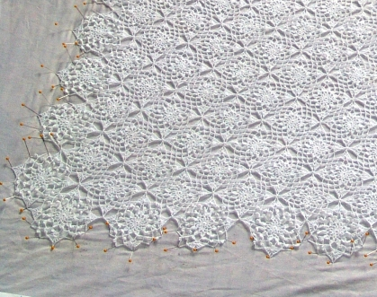 After the lace was all done, we washed it in hot water to shrink it, and then pinned it out to dry in the shape we wanted. Once it dries, the thread will hold it's delicate shape.