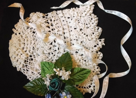 Reproduction of the bonnet Lillie Lang Robison made for her daughter, Birdie Isabella Robison Swasy, by her granddaughter, Mary Swasey Rockwood