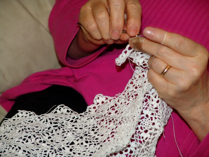 Mary working the last square of the blanket lace.